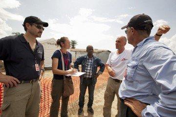 Dr. Lance Plyler talks with MSF doctors at the Foya Case Management Centre