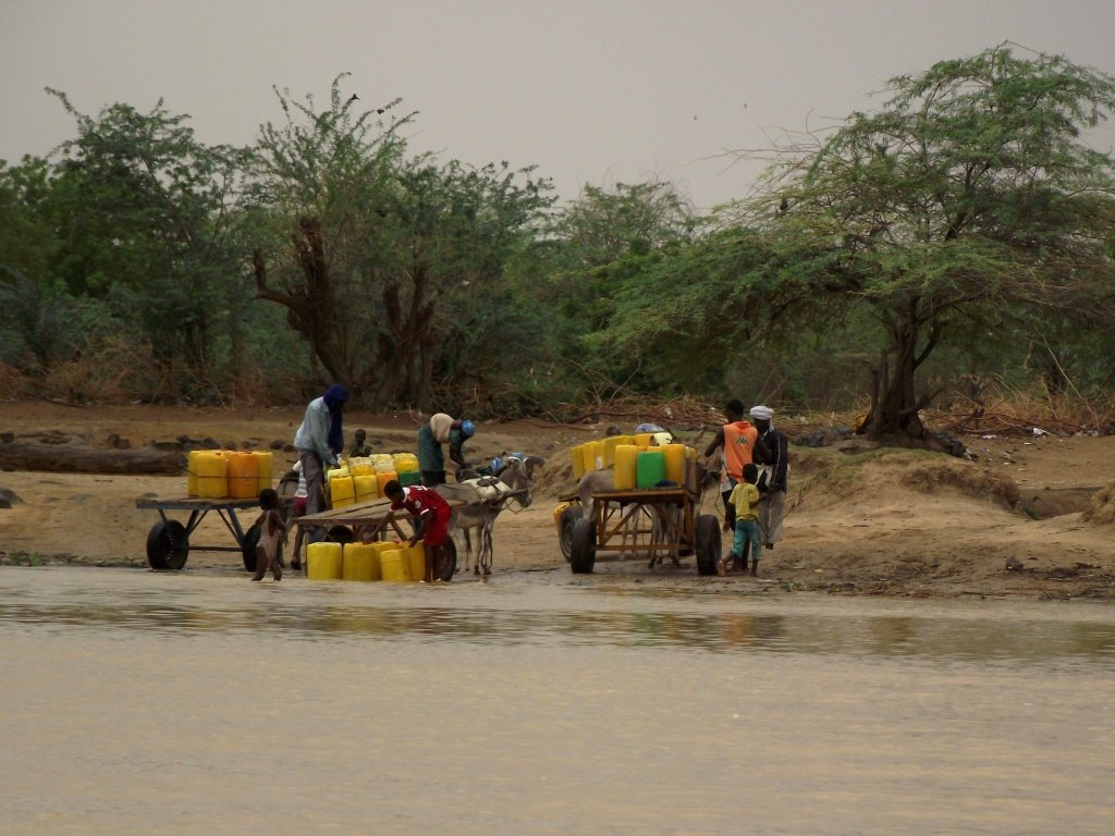 Villagers-collecting-water-from-the-river-compressed