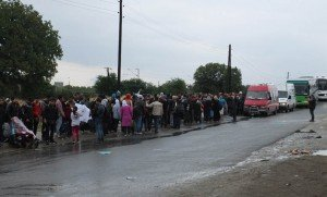 Refugees queue on a bridge heading into the town of Gevgelija, just across the border from Greece.