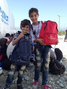 Tima 9 and Tala 11 were delighted to receive backpacks from Samaritan's Purse with a blanket, poncho, hygiene items and, most popular of all, a toy