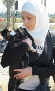 Syrian refugee Amena and her cat have made a long journey through Eastern Europe.