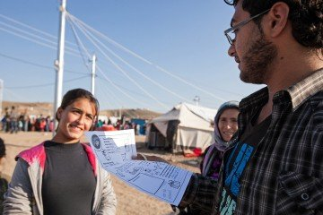 Mizgin, a translator, reads a letter from a girl named Megan that Heyat received in her box.