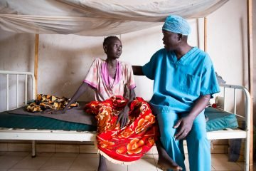 Dr. Evan Atar speaks with a patient at the Maban County Hospital in South Sudan.