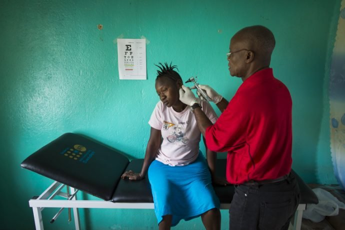 Esther Fayieh receives a check up at the survivors' clinic in Lofa County, Liberia.