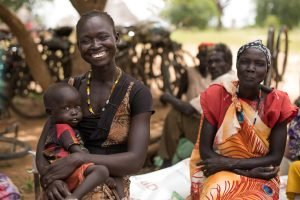 Rebeccah, food reciepient, mother of 3. Food Distribution near Akuem
