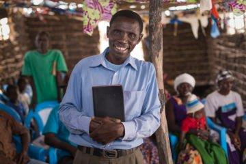 Pastor William Kenga stands inside Biyubu Soul Harvest Church that Samaritan's Purse helped construct.