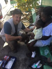 Dr. Lance Plyler treating a patient in southern Haiti after Hurricane Matthew.