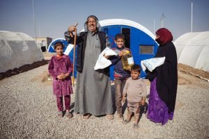 62-YEAR-OLD ABDUL RAHMAN* WITH SOME OF HIS FAMILY. THEY RECEIVED THE MONTHLY FOOD RATION NOV. 7. HE ALLOWED SAMARITAN'S PURSE TO PRAY FOR HIM AND HIS ILLNESSES.