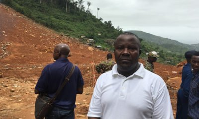 The earth behind survivor Daniel Moijueh shows the aftermath of devastating flooding that claimed seven family members.
