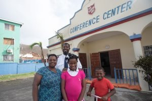 Pastor Lapaix and his family are helping their neighbours recover.