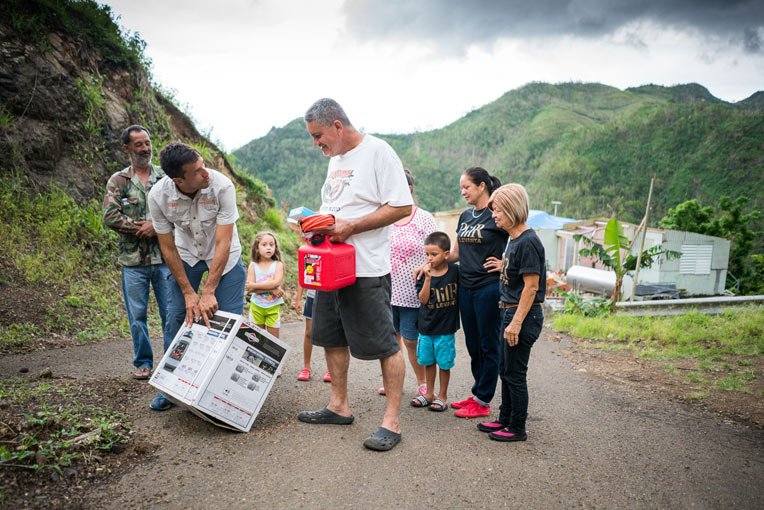 Emilio Rodriguez learns about the generator his family received from Samaritan's Purse. It will be used at the home of his disabled brother and sister.