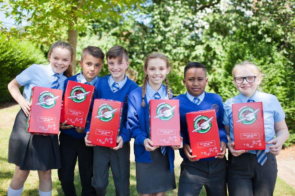 UK School children with shoeboxes