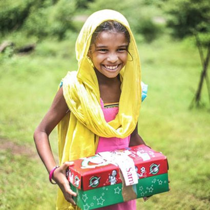 Girl holding shoebox gift