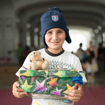Boy holding shoebox gift