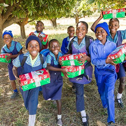 Group of children with shoebox gifts in Zimbabwe