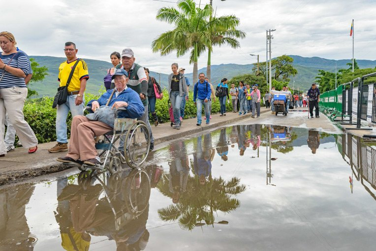 Every day tens of thousands of migrants travel from Venezuela to Colombia where they hope to help meet their families' basic needs.