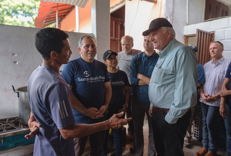 Franklin Graham meets with Jose Luis Ochoa. He was brought to Christ at the shelter and was baptised in the nearby river.