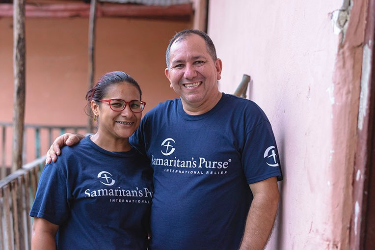 Pastor Jesus Paez and his daughter Viviana are at the shelter serving migrants on a daily basis.