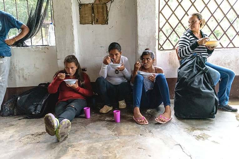A group of women stop for soup at our shelter in La Don Juana.