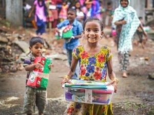 Girl outside with shoebox gift