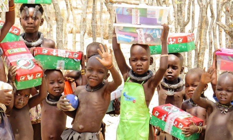 Himba Children receiving shoebox gifts