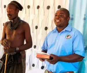 The village chief translating the service