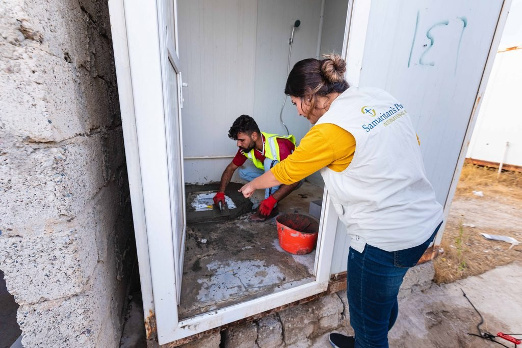 Samaritan's Purse is repairing latrines in the camp to promote better hygiene during this time of crisis.