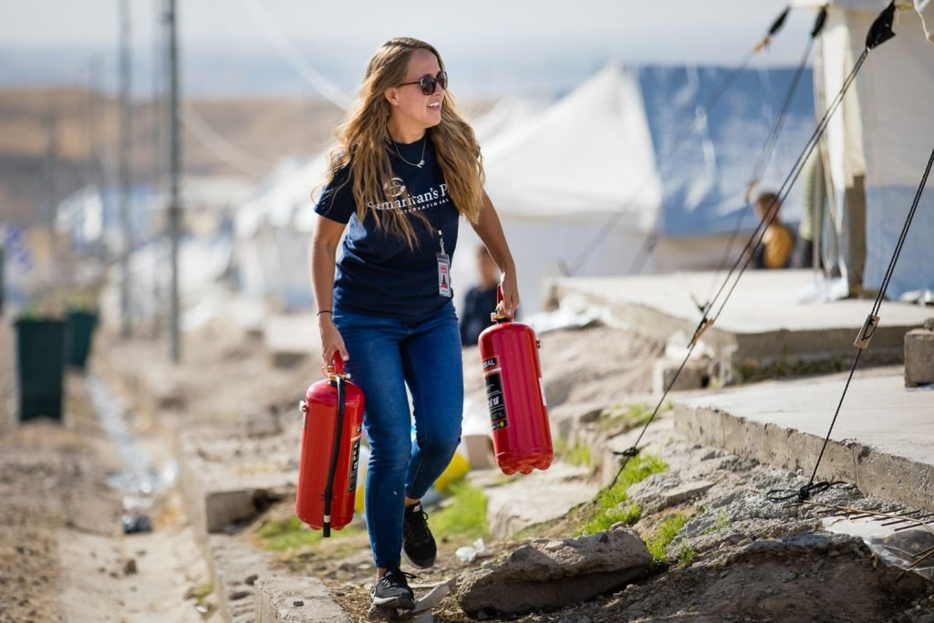 The Samaritan's Purse team distributed fire extinguishers in Bardarash camp to aid refugee families who cook and heat with kerosene.