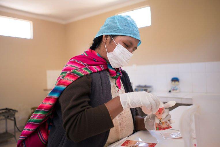 A community member makes yogurt at the processing center we built in Chuma.