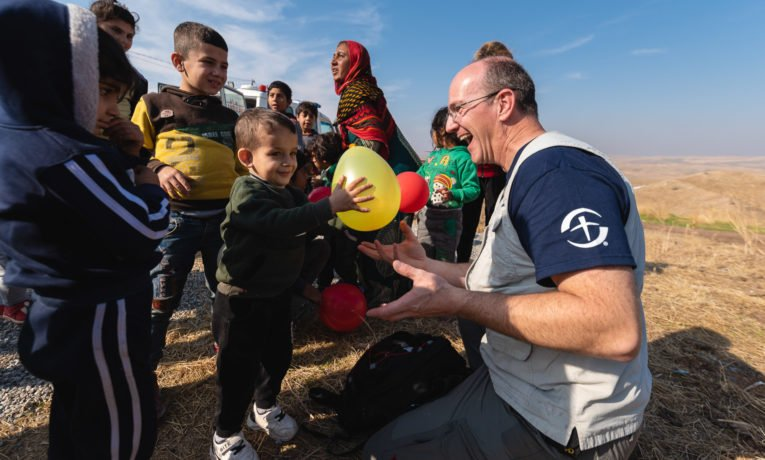 Randy Wesnitzer took time to play with a group of young Syrian refugees in Iraq.
