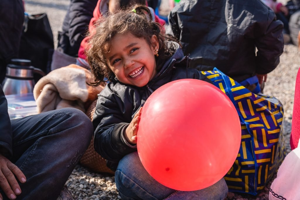 A young Syrian refugee named Hana* played with a red balloon she received from Samaritan's Purse.
