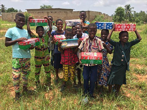 group of children with shoebox gifts