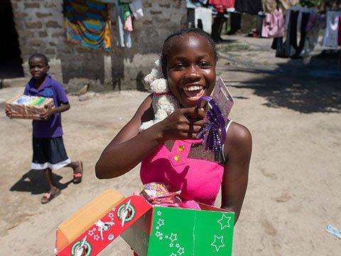 Teenage girl with shoebox gift