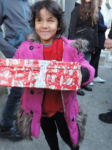 little girl with shoebox gift