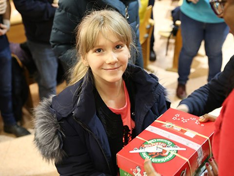 Smiling girl with shoebox gift
