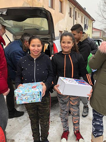 Girls with shoeboxes in snow