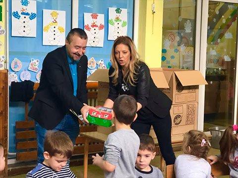 Kindergarten class receiving shoebox gifts