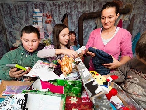 Family in Serbia unpack gifts