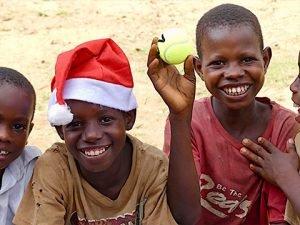 Children receive Santa hat and tennis ball