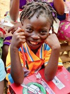 Smiling child with shoebox
