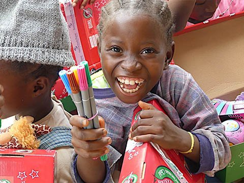 girl smiles with new pens