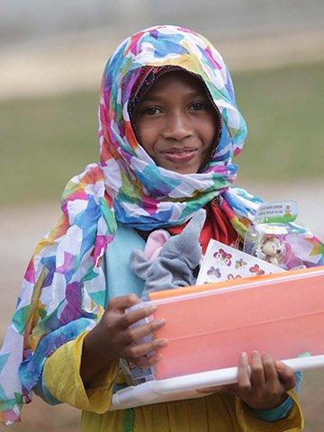 Girl with pink shoebox gift