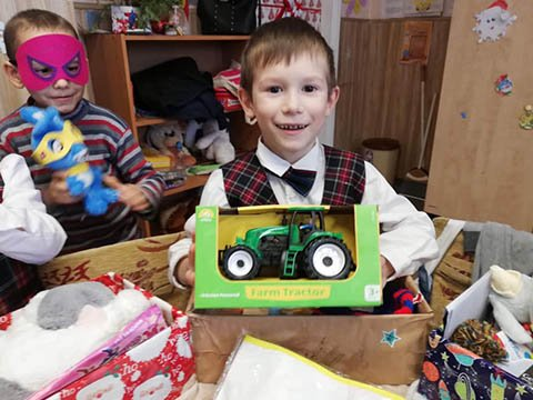 boy with tractor from shoebox gift