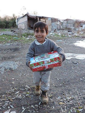 boy holds shoebox gift