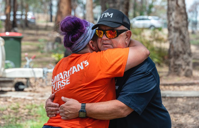 Terry Maki thanks Samaritan's Purse volunteer Amy Jarrett for helping recover personal belongings from the ashes of his home.