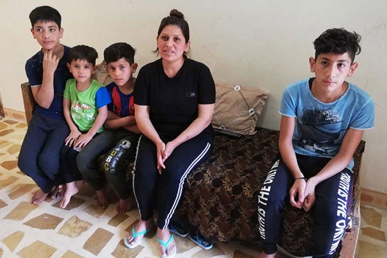 Enas and her children were grateful to receive relief supplies from Samaritan's Purse.
