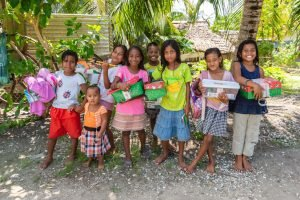 Children gather to celebrate the new gifts they've received. These boys and girls not only received special presents but also an opportunity to hear the Gospel of Jesus Christ.