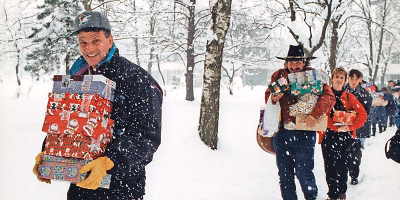 Franklin Graham leads a team to deliver Operation Christmas Child shoeboxes to boys and girls in Bosnia in 1995