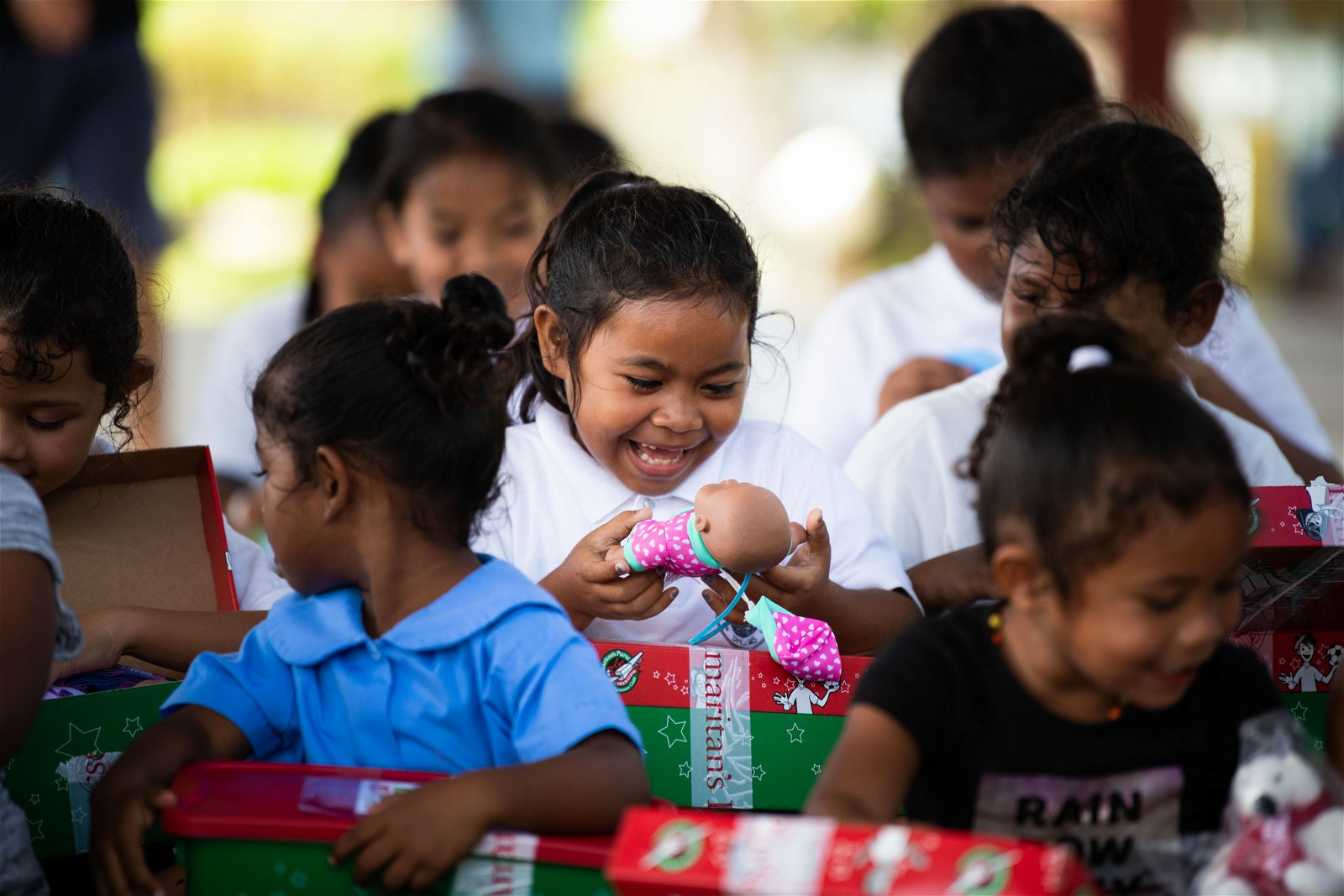 JOY ERUPTS IN CHILDREN AT PELELIU ELEMENTARY SCHOOL WHEN THEY RECEIVE THEIR OPERATION CHRISTMAS CHILD SHOEBOX GIFTS.