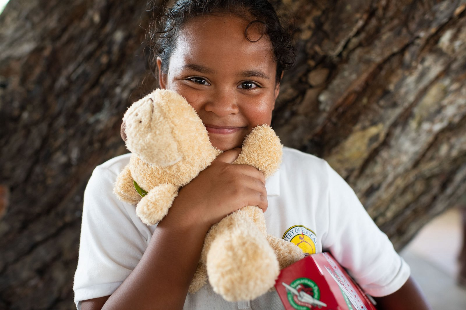 A GIRL ON NGIWAL TREASURES THE STUFFED ANIMAL SHE FOUND IN HER SHOEBOX GIFT.